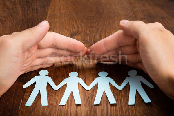 Person Hand Protecting Human Figure Cutout Stock photo © AndreyPopov