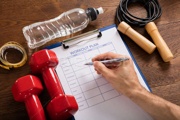 Persoon vulling training plan vorm Stockfoto © AndreyPopov