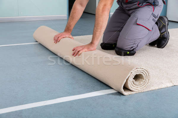 Worker's Hands Rolling Carpet Stock photo © AndreyPopov