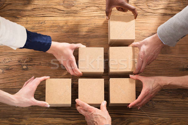 Businesspeople Arranging The Wooden Block Stock photo © AndreyPopov