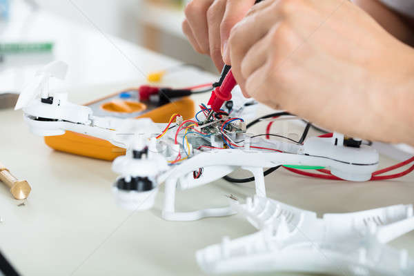 Man Testing Electric Current Of Drone Using Multimeter Tool Stock photo © AndreyPopov