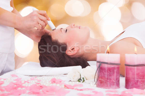 Woman Undergoing Microdermabrasion Therapy On Forehead Stock photo © AndreyPopov