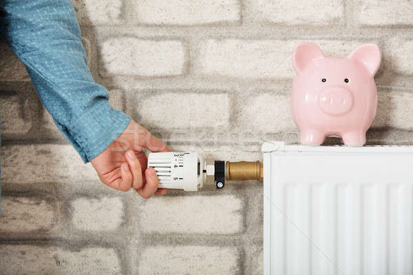 Piggy Bank On Radiator Stock photo © AndreyPopov