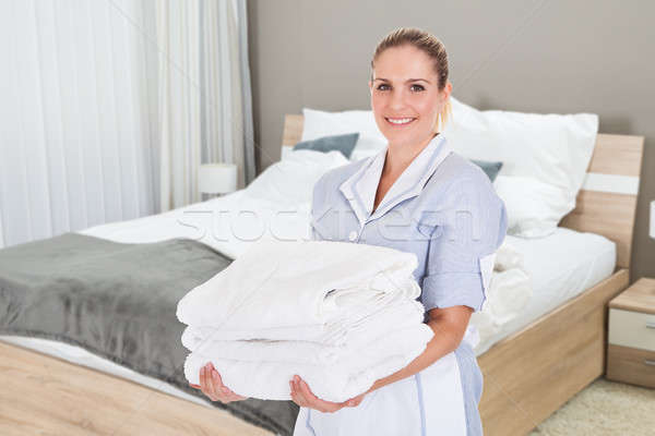 Portrait Of Hotel Maid Holding Clean Towels Stock photo © AndreyPopov
