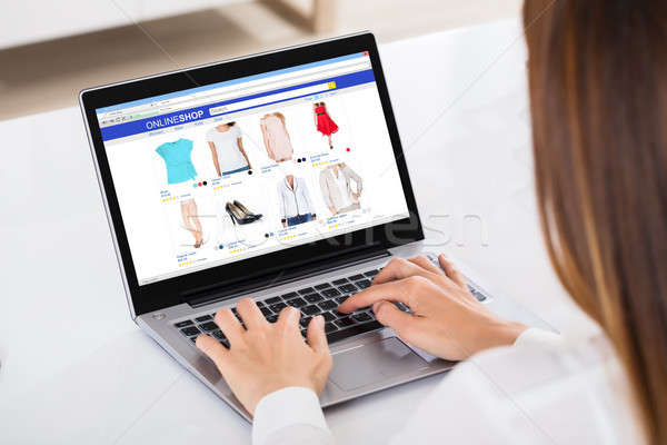 Businesswoman Shopping On Laptop Stock photo © AndreyPopov