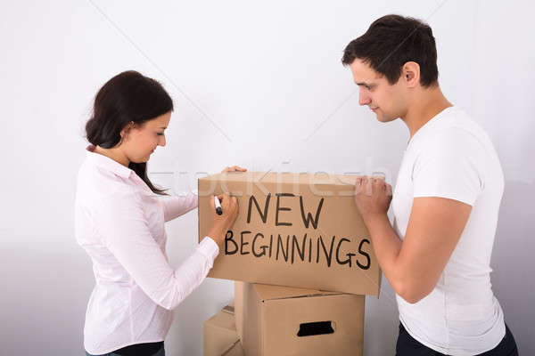 Woman Writing On Cardboard Box New Beginnings Stock photo © AndreyPopov