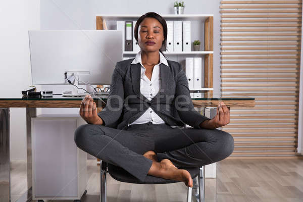 African Woman Meditating On Chair Stock photo © AndreyPopov