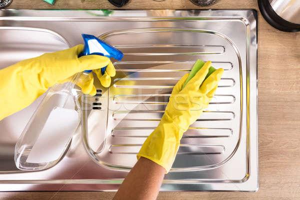 Pessoas mão limpeza aço inoxidável afundar Foto stock © AndreyPopov