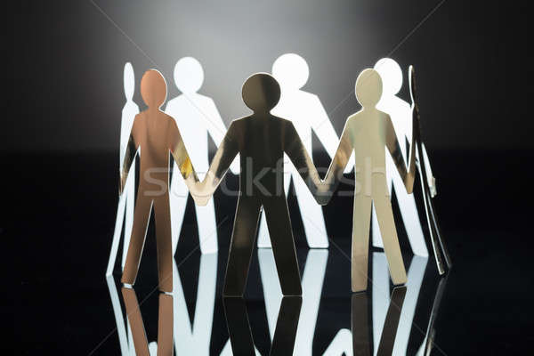 Close-up Of Paper Cut Out Human Figures Stock photo © AndreyPopov