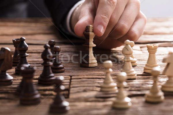 Re pezzo degli scacchi mano legno Foto d'archivio © AndreyPopov