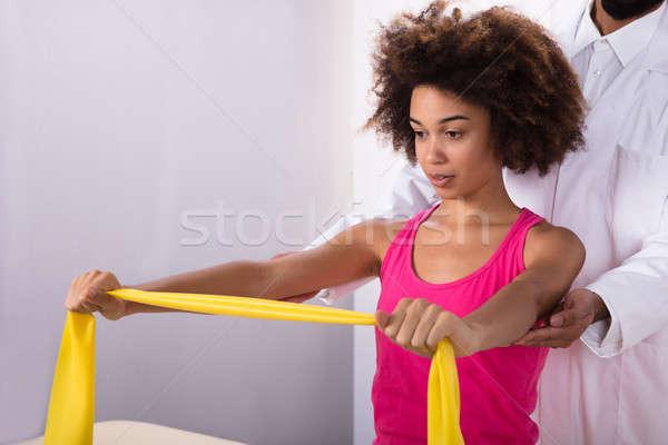 Donna esercizio band medico muscolare Foto d'archivio © AndreyPopov