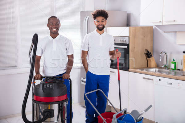 Portrait Of Two Happy Male Janitor In The Kitchen Stock photo © AndreyPopov