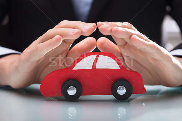 Person's Hand Protecting Red Car Stock photo © AndreyPopov