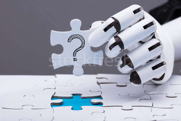 Robot Solving Jigsaw Puzzle Stock photo © AndreyPopov