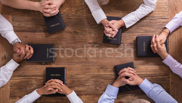 Povos oração mãos bíblia Foto stock © AndreyPopov