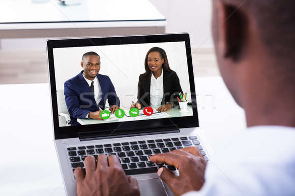 Businessman Attending Video Conference Stock photo © AndreyPopov