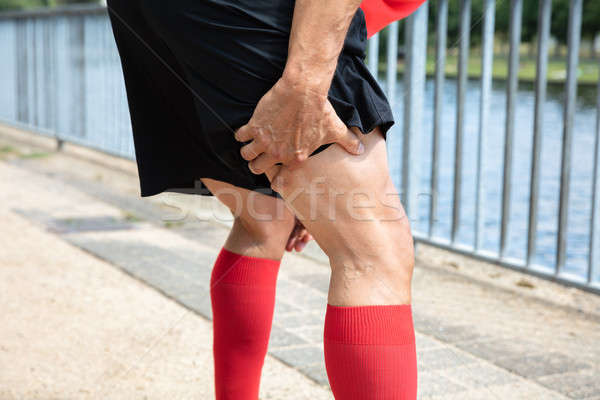 Runner Holding His Injured Leg Stock photo © AndreyPopov