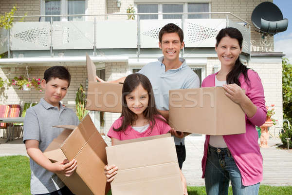 Young family shifting into new house Stock photo © AndreyPopov