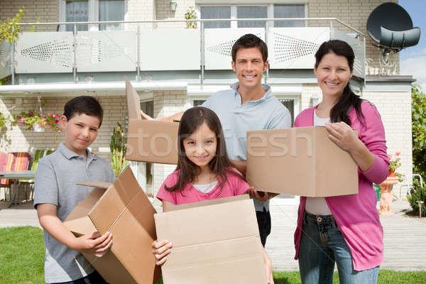 Fiatal család új ház boldog mozog új otthon Stock fotó © AndreyPopov