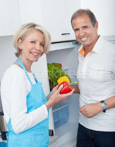 Mature Couple Holding Vegetables Stock photo © AndreyPopov