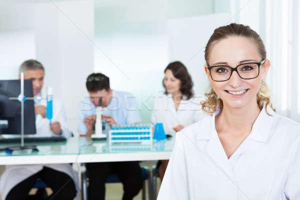 Attractive female lab technician Stock photo © AndreyPopov