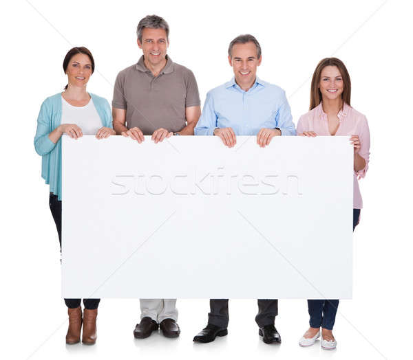 Group Of Happy People Holding Placard Stock photo © AndreyPopov