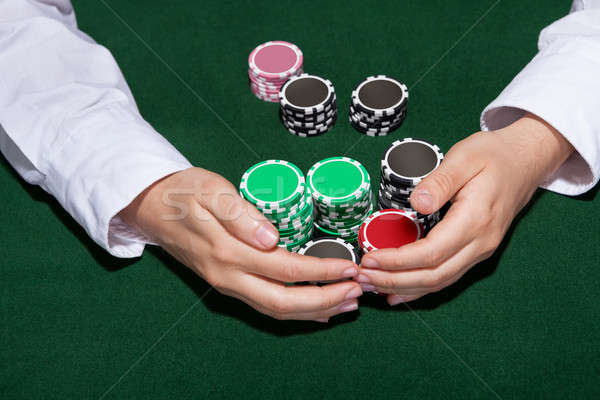 Croupier collecting in the bets Stock photo © AndreyPopov