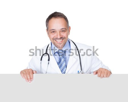 Portrait Of A Doctor Holding Blank Placard Stock photo © AndreyPopov
