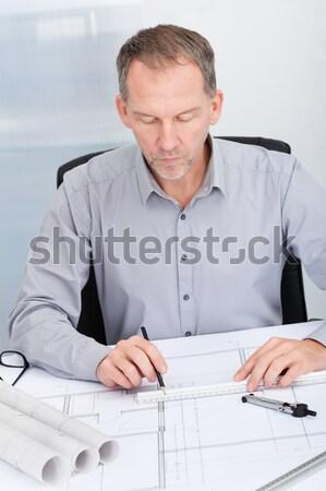 Fiatal férfi építész dolgozik terv asztal Stock fotó © AndreyPopov