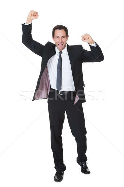 Excited businessman celebration success Stock photo © AndreyPopov