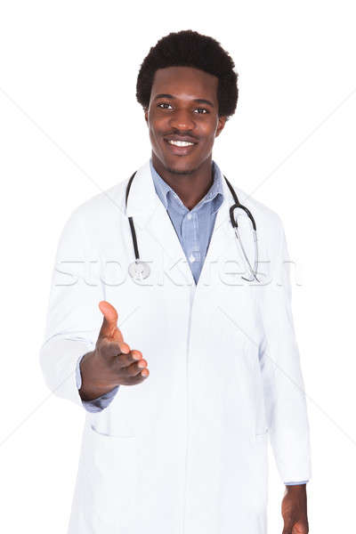 Male Doctor Extending Hand To Shake Stock photo © AndreyPopov