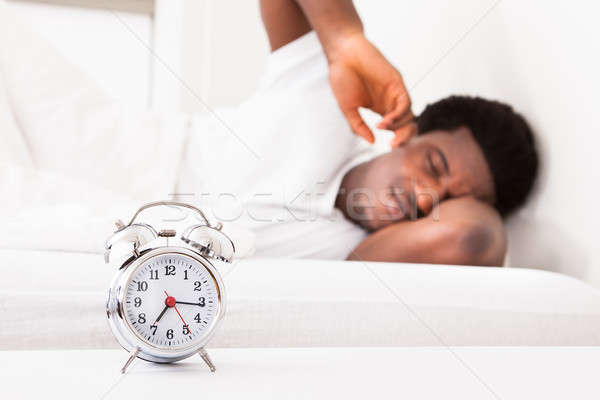 Frustrated Man In Front Of Alarm Clock Stock photo © AndreyPopov
