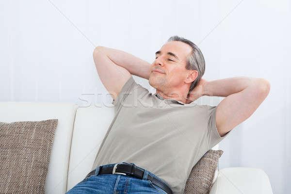 Mutlu olgun adam rahatlatıcı kanepe portre ev Stok fotoğraf © AndreyPopov
