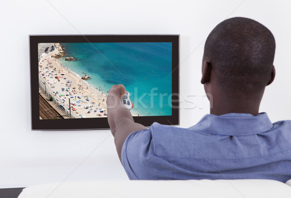 Stock photo: African Man Changing Channel