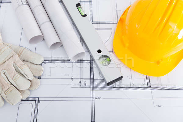Spirit Level; Hardhat And Gloves On Blueprint Stock photo © AndreyPopov