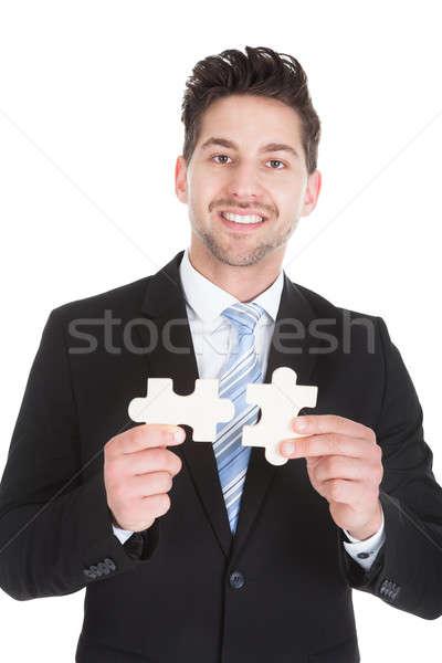Adulto empresário peças do puzzle retrato branco Foto stock © AndreyPopov