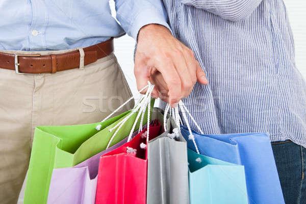 Párok kezek tart tarka bevásárlótáskák közelkép Stock fotó © AndreyPopov