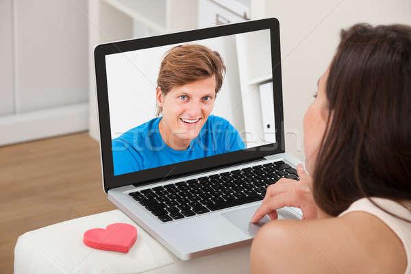 женщину видео дружок ноутбука домой Сток-фото © AndreyPopov