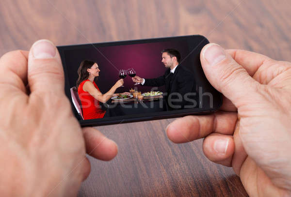 Person Holding Cellphone Watching Video Stock photo © AndreyPopov