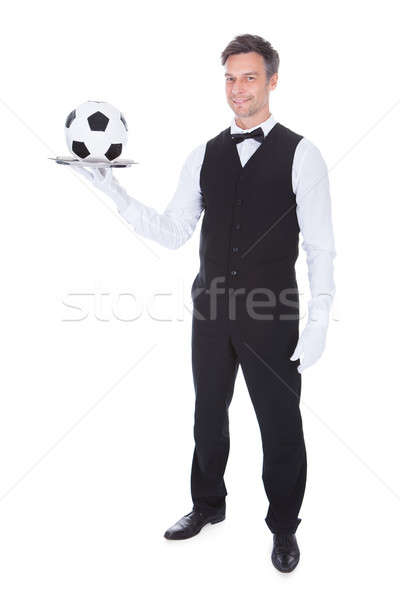 Male Waiter Carrying Football Stock photo © AndreyPopov