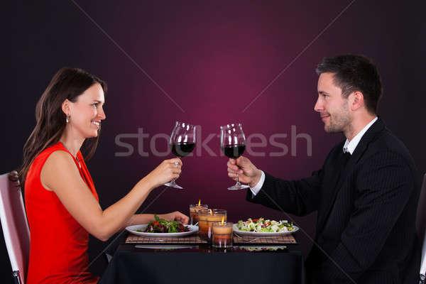Couple Tossing Wine Glass Stock photo © AndreyPopov