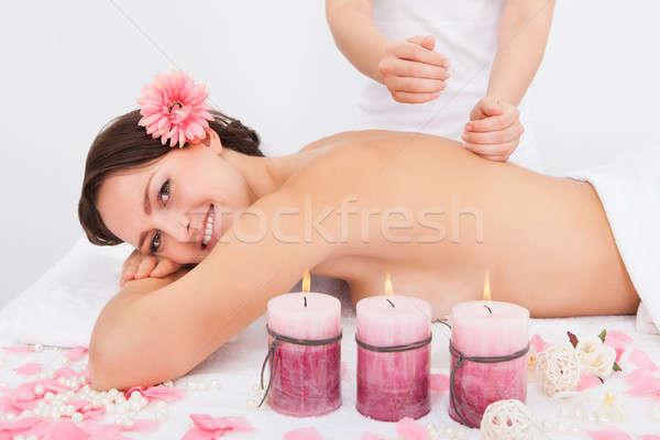 женщину массаж лечение улыбаясь цветок Сток-фото © AndreyPopov