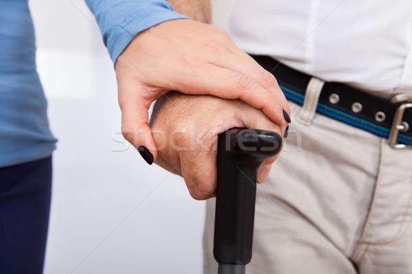 Closeup Of Caretaker With Disabled Senior Man Stock photo © AndreyPopov