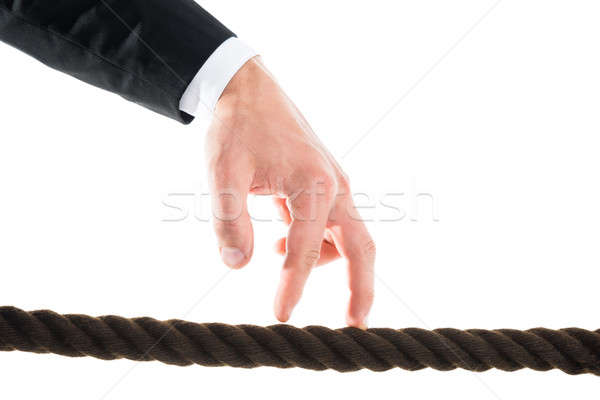Stock photo: Businessman's Hand Walking On Rope