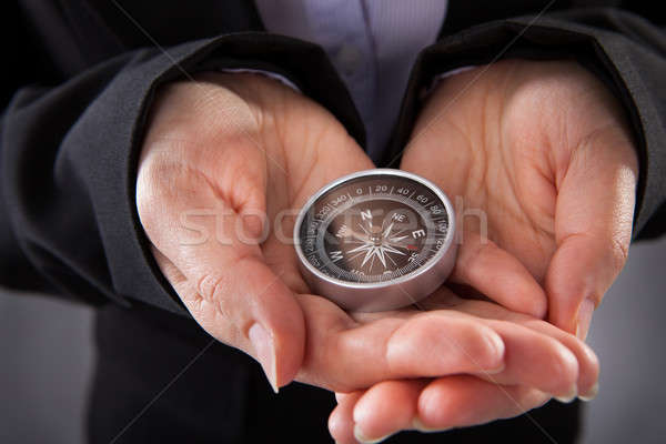 Businessperson Holding Compass Stock photo © AndreyPopov