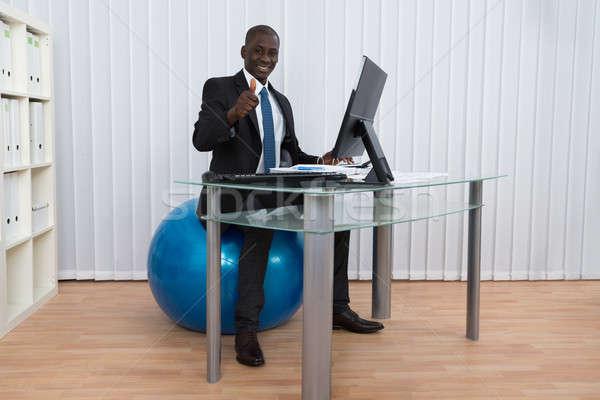 Empresário trabalhando sessão pilates bola retrato Foto stock © AndreyPopov