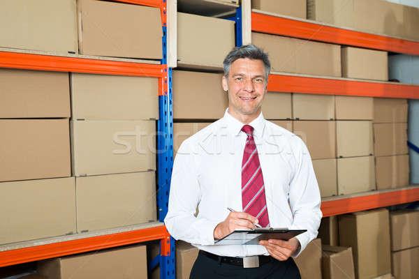 Stockfoto: Manager · distributie · magazijn · gelukkig · schrijven