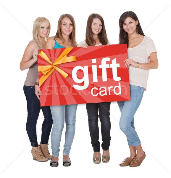Grupo mujeres tarjeta de regalo jóvenes hermosa Foto stock © AndreyPopov