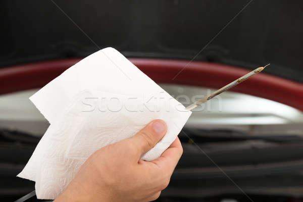 Car Mechanic Holding Dipstick To Repair Car Stock photo © AndreyPopov