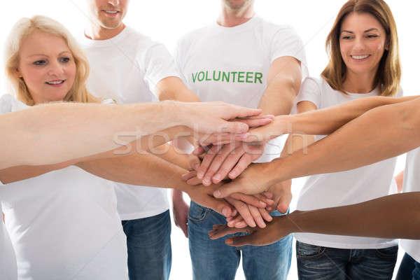 Feliz voluntários mãos em pé branco Foto stock © AndreyPopov